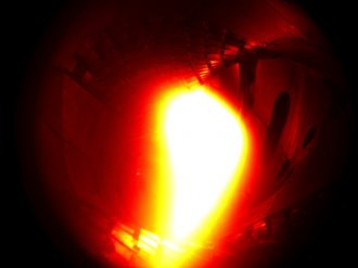 10th December 2015: The first plasma in Wendelstein 7-X. It consisted of helium and reached a temperature of about one million degrees Celsius. (coloured black-and-white photo)