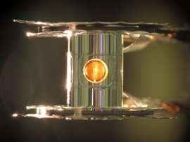 An image of the tiny gold can (known as the hohlraum) with a cutaway showing a fuel capsule inside. Scientists at Lawrence Livermore National Laboratory conducting laser-based nuclear fusion experiments have seen more energy come out of their deuterium-tritium fuel than was put in, they report in Nature.