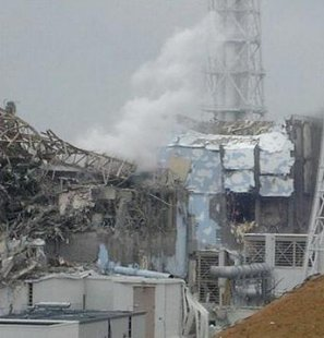 Smoke rises from Tokyo Electric Power Company's Fukushima Daiichi nuclear power plant, March 27, 2011 (Photo courtesy TEPCO)